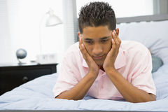 Teenage Boy Lying On Bed Stock Photos
