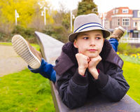 Teenage boy lying on the parapet at the park Stock Image