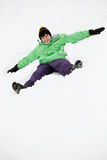 Teenage Boy Making Snow Angel On Slope Royalty Free Stock Photos