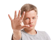 Teenage boy making stop gesture Stock Image