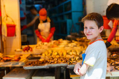 Teenage boy at market Royalty Free Stock Image
