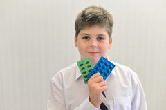 Teenage boy with the medicine in his hands Royalty Free Stock Photography