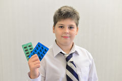 Teenage boy with the medicine in his hands Stock Images