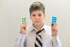 Teenage boy with the medicine in his hands Royalty Free Stock Images