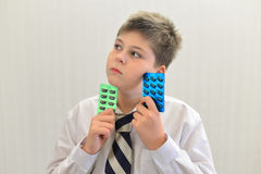 Teenage boy with the medicine in his hands Stock Photo