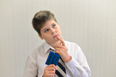 Teenage boy with the medicine in his hands Royalty Free Stock Photos