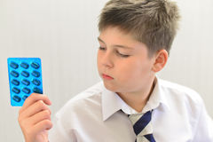 Teenage boy with the medicine in his hands Royalty Free Stock Image