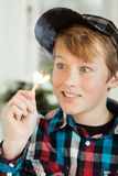 Teenage Boy Mesmerized by Flame of Lit Match Stock Photography