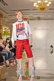 Teenage boy model performs at podium Stock Photos