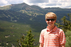 Teenage boy in the mountains Stock Photography