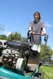 Teenage boy mowing lawn Stock Photos
