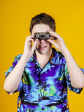 Teenage boy with opera binocular close-up portrait Stock Photo