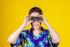 Teenage boy with opera binocular close-up portrait Royalty Free Stock Images