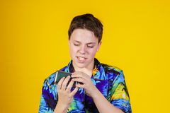 Teenage boy with opera binocular close-up portrait Royalty Free Stock Image