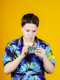 Teenage boy with opera binocular close-up portrait Stock Images
