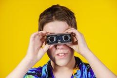 Teenage boy with opera binocular close-up portrait Stock Photography
