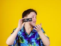 Teenage boy with opera binocular close-up portrait Royalty Free Stock Photos