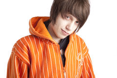 Teenage boy in orange hoodie Royalty Free Stock Images
