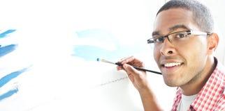 Teenage boy painting. African American Teenage boy painting Royalty Free Stock Photos