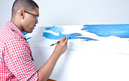 Teenage boy painting Stock Images