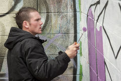 Teenage boy painting graffiti art Stock Photos