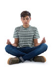 Teenage boy performing yoga Stock Photo