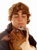 Teenage boy and pet bulldog Stock Photography