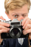 Teenage boy photographing through retro camera Stock Images