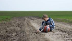 Teenage boy picks his ground Royalty Free Stock Photography