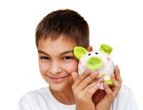 Teenage boy with piggy money box Stock Photos