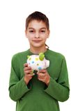 Teenage boy with piggy money box Royalty Free Stock Photo
