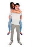Teenage boy piggybacking teenage girl Royalty Free Stock Images