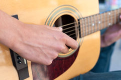 Teenage Boy playing Acoustic Guitar Royalty Free Stock Image