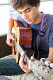 Teenage Boy playing Acoustic Guitar Royalty Free Stock Photo