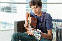 Teenage Boy playing Acoustic Guitar Royalty Free Stock Photography