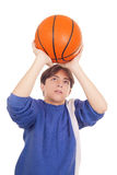 Teenage boy playing basketball. Caucasian teenager playing basketball isolated on white royalty free stock photography