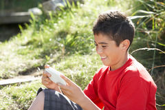 Teenage boy playing with computer game Royalty Free Stock Photos