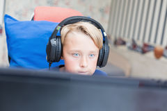 Teenage boy playing computer games on PC Stock Photo