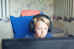 Teenage boy playing computer games on PC Royalty Free Stock Images