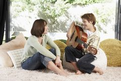 Teenage Boy Playing Guitar Stock Photo