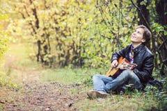 Free Teenage Boy Playing Guitar Stock Photos - 34213743