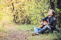 Teenage boy playing guitar Stock Photos