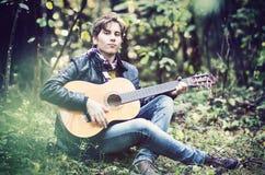 Teenage boy playing the guitar Royalty Free Stock Image