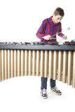 Teenage boy playing marimba in studio Royalty Free Stock Images