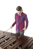 Teenage boy playing marimba in studio Royalty Free Stock Image