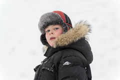Teenage boy playing snow in winter Royalty Free Stock Photos