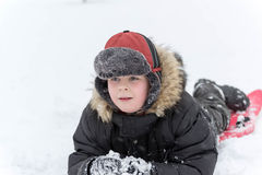 Teenage boy playing snow in winter Royalty Free Stock Image