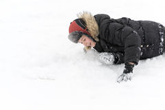 Teenage boy playing snow in winter Stock Photos