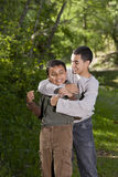 Teenage boy playing with and teasing brother Royalty Free Stock Photography