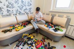 Teenage boy playing with toy cars in  room. Teenage boy playing with toy cars in the room Royalty Free Stock Image